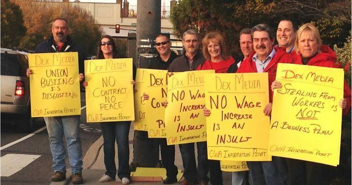 CWA Staff and Officers stand on sidewalk with Dex Media signs.