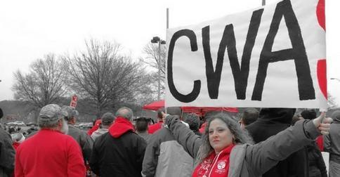 CWA Frontier members rally and hold CWA sign.